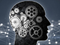 silhouetted head in profile with gears and futuristic shape in background