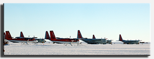 LC-130s and Twin Otters parked at Pegasus Airfield near McMurdo Station