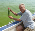 Scientist Hans Paerl holding a bottle with algae in water from in Lake Taihu.