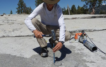 Researcher  extracting a granite core