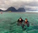 Scientists Monica Medina and Joseph Pollock in the water preparing to dive