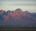 The Organ Mountains are a backdrop for the Chihuahuan Desert and encroaching city of Las Cruces.
