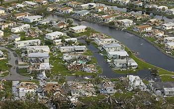 Aerial photo of damaged homes in the aftermath of a hurricane