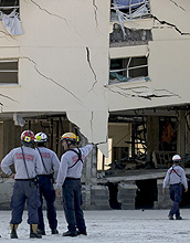 In Pensacola, Fla., engineers check a  building for structural integrity following Hurricane Ivan.