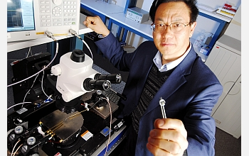 Georgia Tech researcher Zhong Lin Wang holds a prototype nanogenerator.