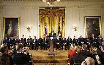 President Bush at the podium and recipients of National Medals at the White House ceremony