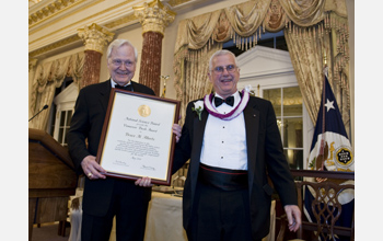 NSB Awards Chairman Ray Bowen presents the 2010 Vannevar Bush Award to Bruce Alberts.