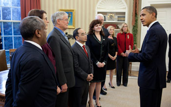 Image of President Obama greeting the 2010 and 2011 PAESMEM awardees on Dec. 12, 2011.