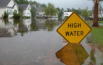 Flooded area with high water sign