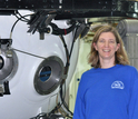 Marine scientist Amy Baco-Taylor next to a submersible in which she has conducted research.