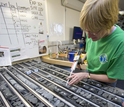 A researcher on a previous IODP expedition labels pieces of core collected while at sea.