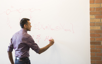 Professor Sham M. Kakade at a whiteboard.