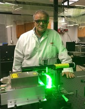 Aristides Marcano, professor of physics at Delaware State University, works in the school's laboratory of quantum optics.