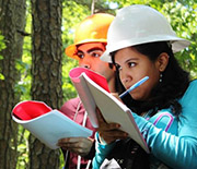 Students in hard hats take notes in Mark Twain National Forest.