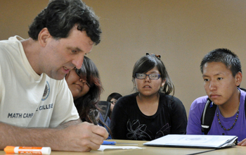 Kansas State University David Auckly works with students at a summer math camp.