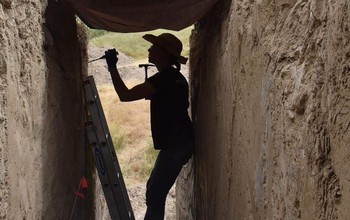 Naomi Ward, University of Wyoming associate professor of molecular biology, collects soil samples for microbiome analysis at the LaPrele Creek mammoth kill site near Douglas, Wyoming.