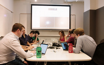 Team of astronomers working at computers.