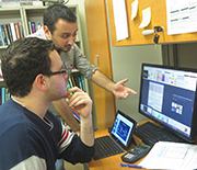 Two students at The City College of New York discuss a research project.