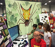 Researchers and children interacting at the