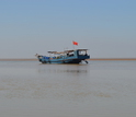 Fishing boat on the Yellow River; the boats often become scientific