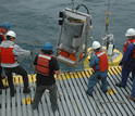 Men deploying of the Environmental Sample Processor (ESP) in the ocean