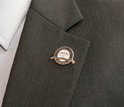 A PAEMST awardee displays his new lapel pin.