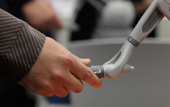 hand hold a robotic hand