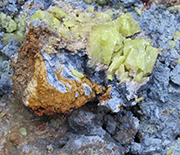 Nodule of Oregon blue clay, coated with red clay and sulfur crystals encased in white clay.