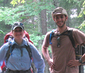 man and woman with hiking gear in a forest