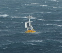 A surface buoy bobs in waves at the OOI Global Argentine Basin site in the Southern Hemisphere.