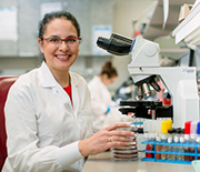 Infectious disease physician Robin Patel looks at blue clay results in her lab at the Mayo Clinic.