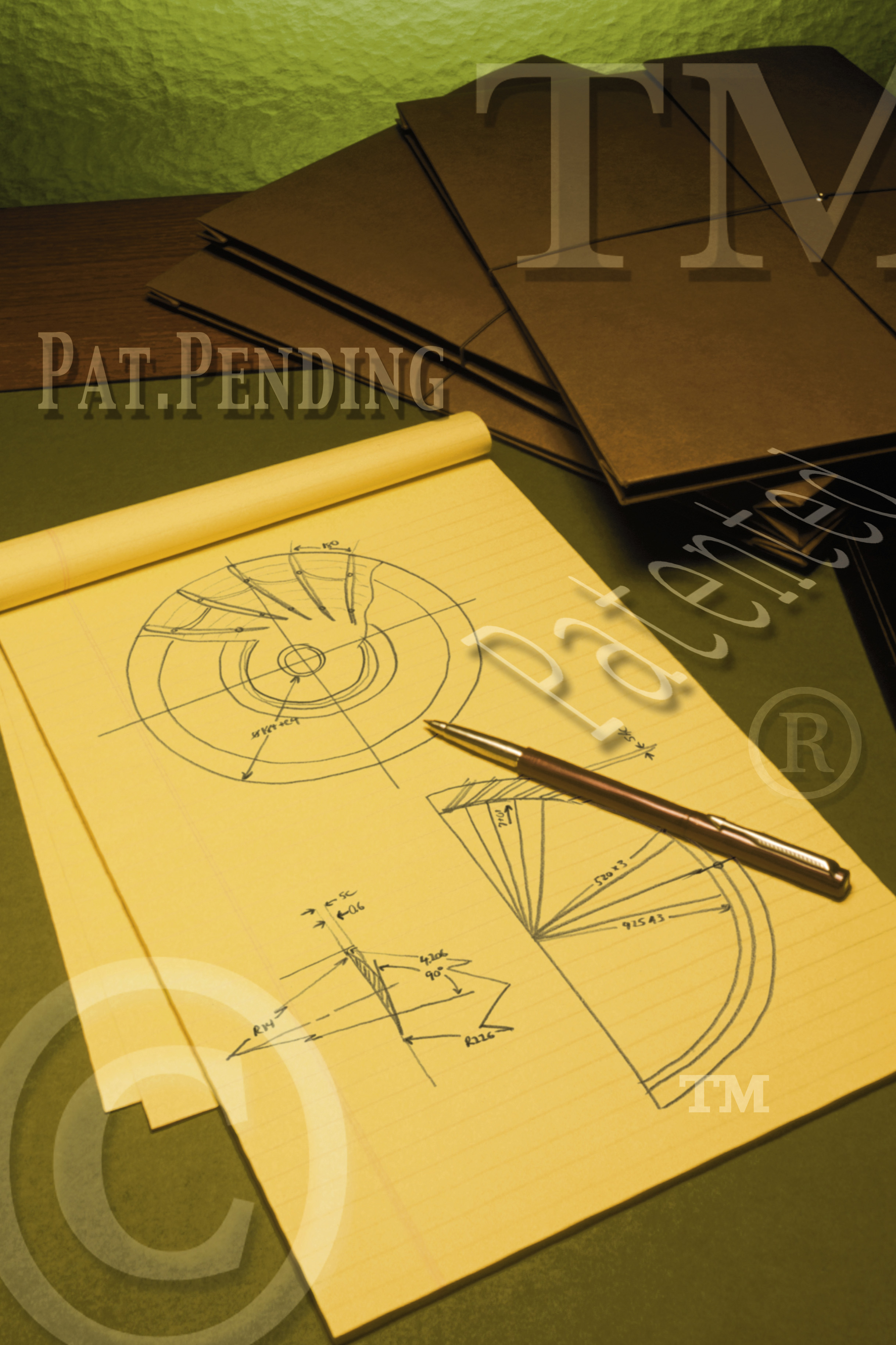 Graphic illustration showing folders,pencil and notepad with drawings and the text pat pending