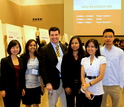 professor with graduate students at conference