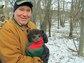 James Hewlett holds a black bear cub