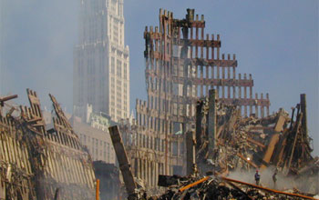 Photo of the Woolworth Building in New York City behind the collapsed World Trade Center.