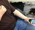Photo of man with statoscope and holding a smart phone with app that can monitor vitals