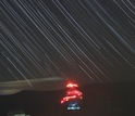 NRAO's Robert C. Byrd Green Bank Telescope surrounded by star trails.