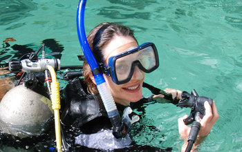 Biogeochemist Anne Cohen with diving gear.