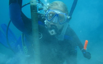 Scientist Hannah Barkley  under water collecting samples