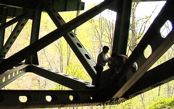 two people working on a bridge