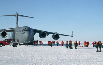 A C-17 and people at McMurdo Station in 2011