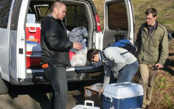 Students pack water samples into a van