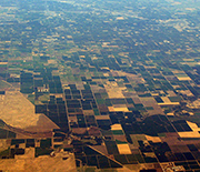 Aerial view of the Central Valley, showing agricultural fields and housing developments.