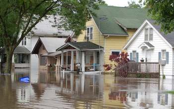 Flooded street and houses in Cedar Rapids, Iowa