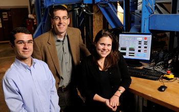 Researchers in front of the Big Blue Baby machine