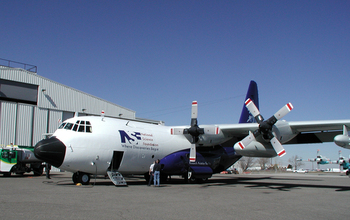 The NSF/NCAR C-130 aircraft outside a hangar