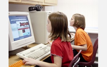 Girls at computers, part of the BUGS--Bringing Up Girls in Science Program.
