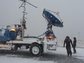 DOW scientists Karen Kosiba and Traeger Meyer with radar truck