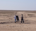 Scientists set up fog collectors in the Namib to collect fog water for chemical analyses.