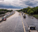 Highway to nowhere: Traffic along a road near Islip, New York, is stalled by heavy rains.